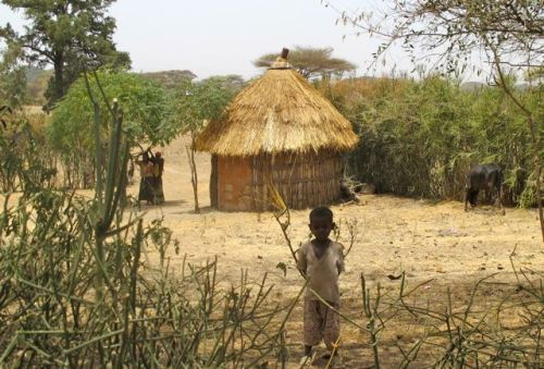 children and traditional house