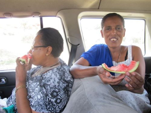 eating watermelon ion car