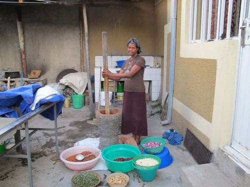 pounding the mixture for berbere