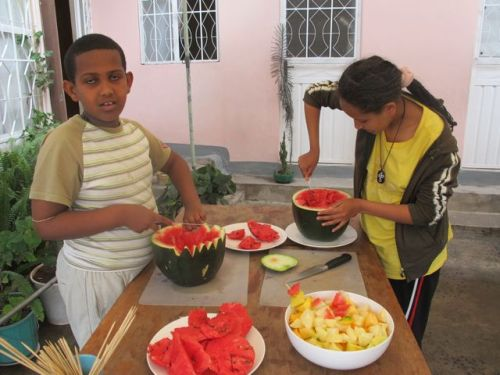 eyob and meron at work on watermelon